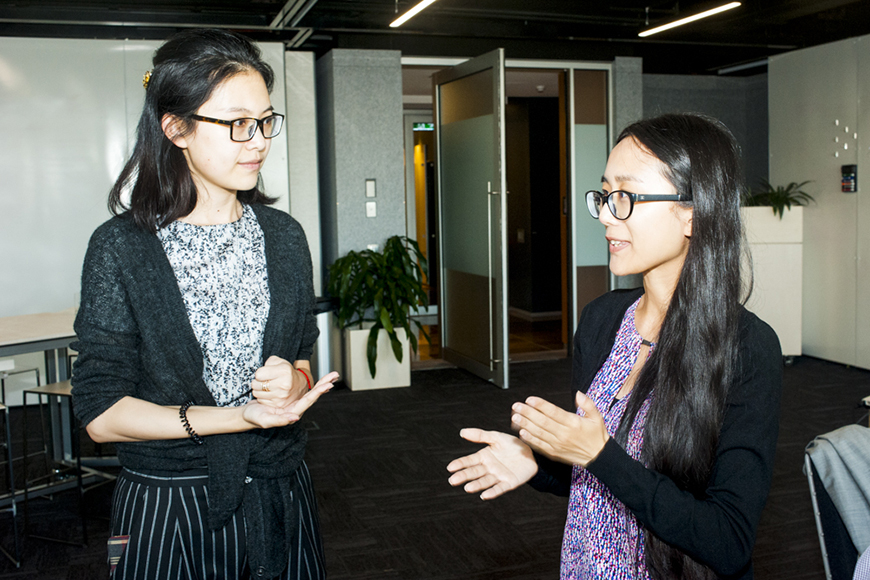 two female international students talking