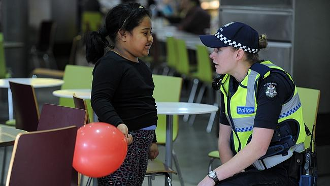 Victoria Police constable talking to a child