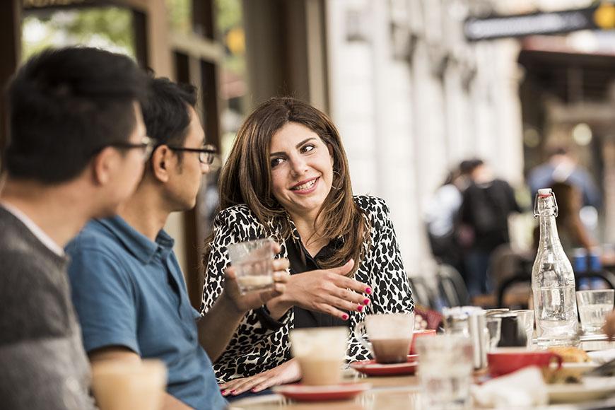 international students sharing coffee