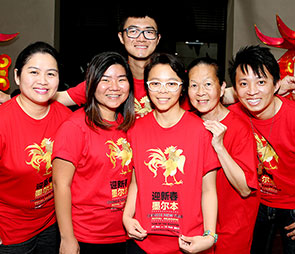 Students in red tee-shirts celebrating Chinese New Year Launch Party 2017