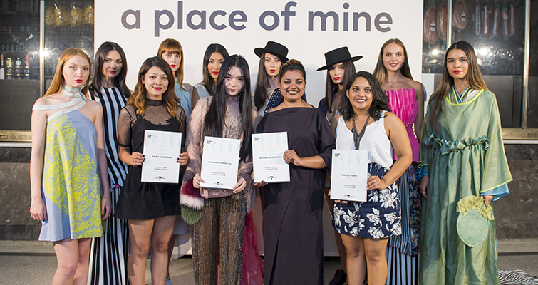 group of young designers and models with certificates